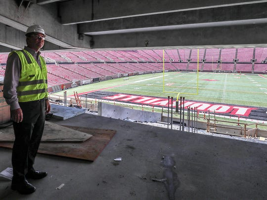Athletic Director Vince Tyra shows the view from the club level seats in the north end zone.