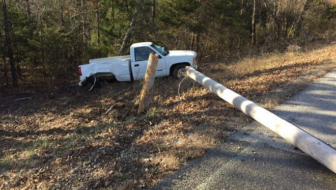 A power pole along Baxter County Road 69 lays split in half following a one-vehicle accident involving a pickup truck driven by Oklahoma resident John Randall Hager on Saturday afternoon. Alcohol may have been involved in the crash that sent Hager to Baxter Regional Medical Center.