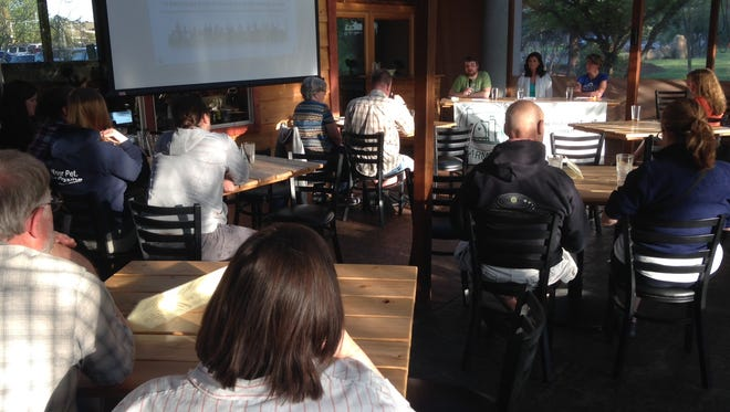 Attendees learn how to buy local meat at the  InFARMation event on March 2, 2016, at Gilgamesh Brewery.