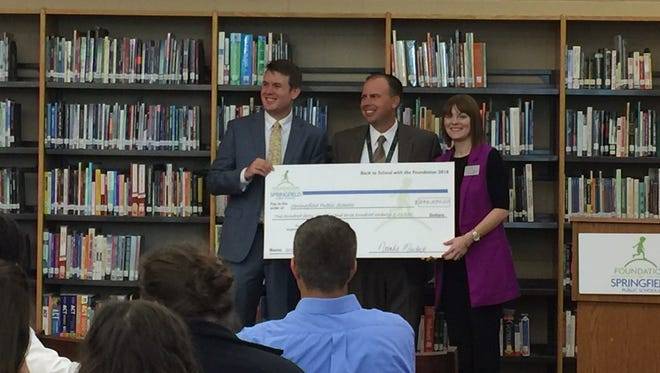 Matt Simpson, president-elect for the Foundation for Springfield Public Schools, Dr. John Jungmann, superintendent for Springfield Public Schools, Natalie Murdock, executive director for the Foundation for Springfield Public Schools present a grant check.