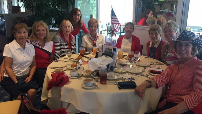 "Members of the Legacy Ladies Golf Association enjoy lunch at its rained out ""Celebrate America"" golf tournament on Nov. 15."