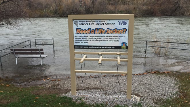 A sign advertising life jackets is seen near the Truckee River at Crissie Caughlin Park on April 6, 2018.