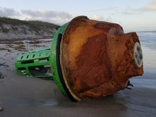 Mystery buoy washes ashore Satellite Beach