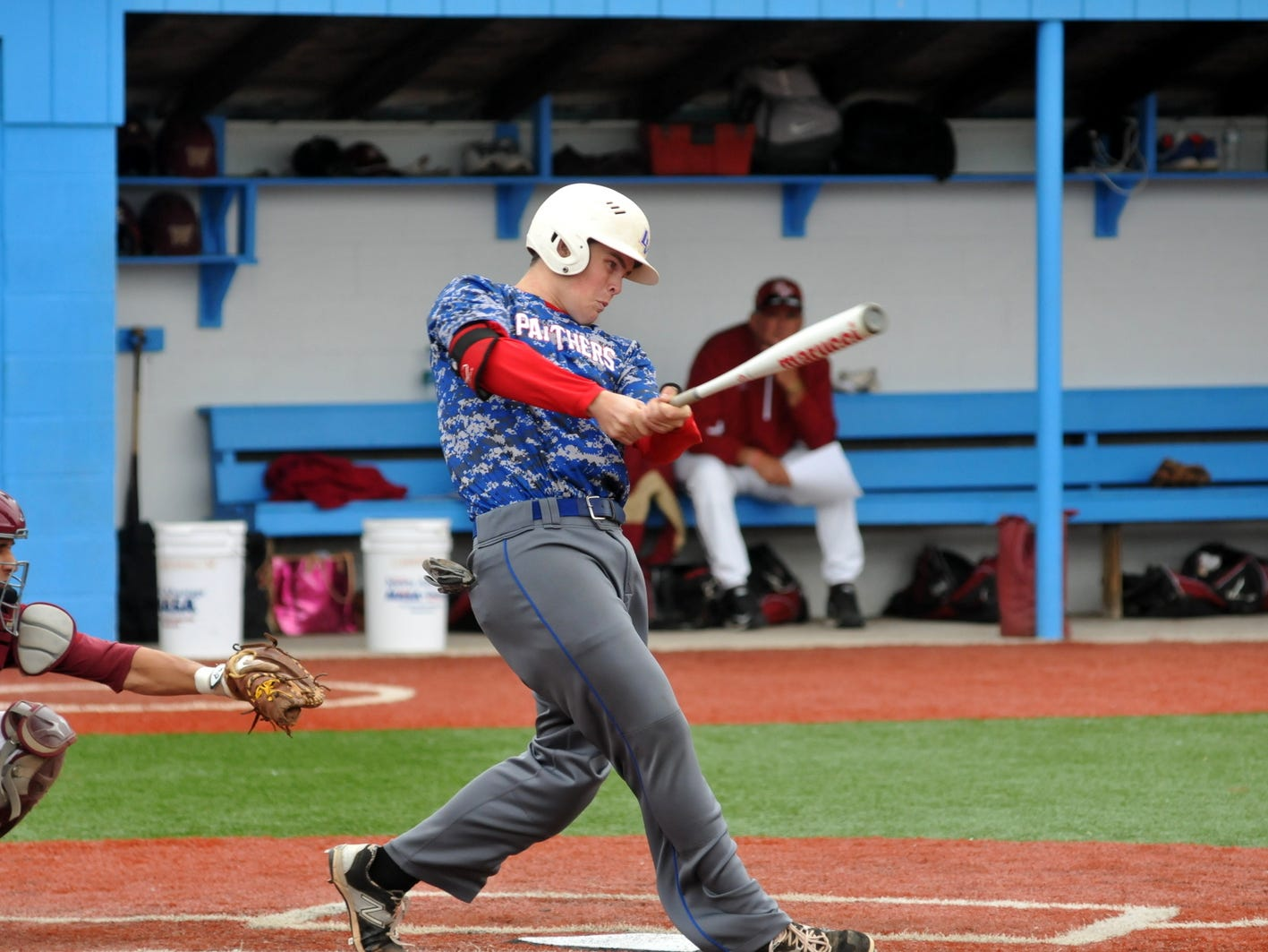 Licking Valley's Jacob Dennis hits a first-inning RBI single Thursday at Lancaster's Beavers Field. The Panthers lost 2-1 to Bishop Watterson in the Division II district finals.