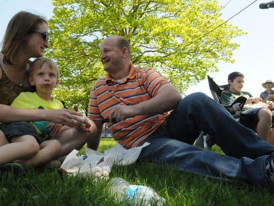 Chad and Brigette Shefchik along with son Patrick find a patch of grass at Martin Park for their side pork picnic.