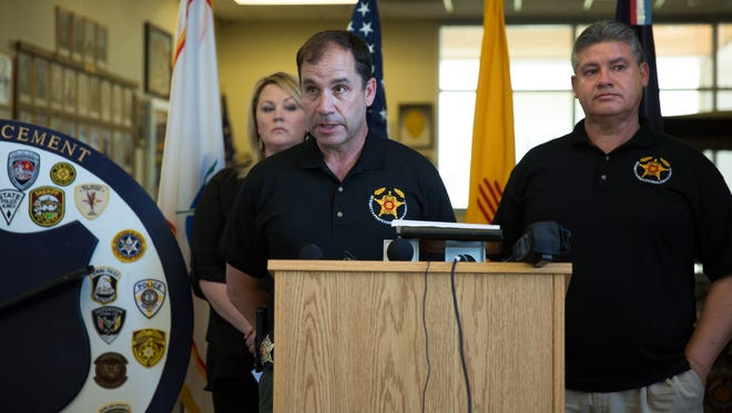 Doña Ana County Undersheriff Ken Roberts, center, speaks during a press conference, August 13, 2016, involving the death of Hatch Police Officer Jose Chavez. With him is Doña Ana County Sheriff Enrique Vigil, right, and Public Information Officer for DASO Kelly Jameson.