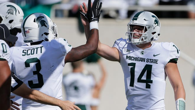 Michigan State quarterback Brian Lewerke, right, has created a buzz with his start to this season. He'll be tested in new ways against Notre Dame.