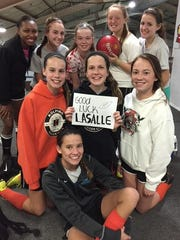 Girls from the Kolping Elite soccer team wish the La