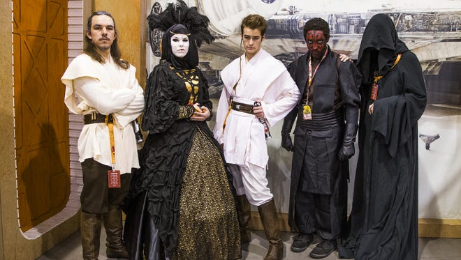 Cosplay participants pose at Phoenix Comicon , Saturday, May 27, 2017, at the Phoenix Convention Center.