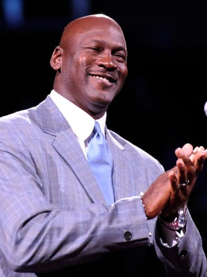Dec 21, 2013; Charlotte, NC, USA; Charlotte Bobcats owner Michael Jordan unveils the new Charlotte Hornets logo at halftime during the game against the Utah Jazz at Time Warner Cable Arena. Mandatory Credit: Sam Sharpe-USA TODAY Sports