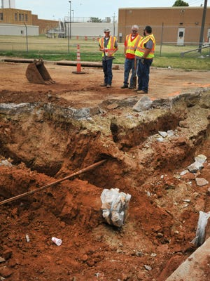 In this file photo, Wichita Falls Water Distribution employees work to repair a broken water main line near the Jasper Water Plant. City council will be considering a bid from Bowles Construction at their meeting Tuesday for a nearly $1.5 million project to replace old waterlines and eliminate dead end mains.
