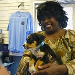 Wanda Gaines holds one of her two newly adopted dogs Monday at Southern Pines Animal Shelter. The shelter offered a four-day free pet adoption from Nov. 27 to Nov. 30.
