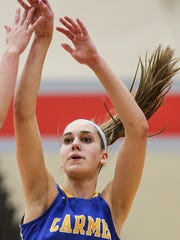 Dilk watches her shot during semifinals action between the Carmel Greyhounds and Noblesville Millers at Fishers High School on Feb. 2, 2018.   Carmel won, 50-45.