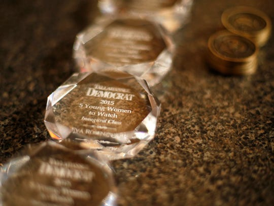 Crystals with winner's names inscribed wait for the