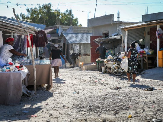Vendors set up their wares along the street on March