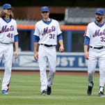 New York Mets pitchers Jacob deGrom, left, Steven Matz, center, and Matt Harvey walk to the dugout before the baseball game against the Chicago Cubs at Citi Field, Sunday, July 3, 2016 in New York. (AP Photo/Seth Wenig)