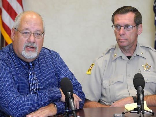 Harrisburg superintendent Jim Holbeck and Lincoln County sheriff Dennis Johnson talk during a briefing following a shooting incident at the high school in 2015.