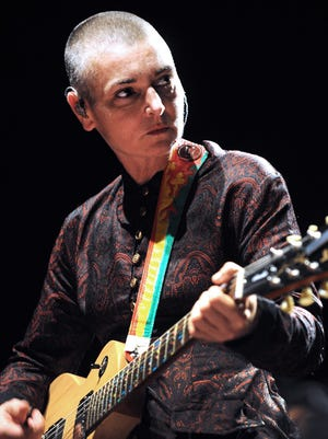 """This file photo taken on Aug. 11, 2013, shows  Irish singer Sinead O'Connor performing in Lorient, France, during the Inter-Celtic Festival of Lorient. Sinead O'Connor is safe and """"receiving the best of care,"""" a post on her Facebook page said Aug. 8, 2017, after the Irish singer posted a tearful video in which she said she was """"fighting ... to stay alive."""""""