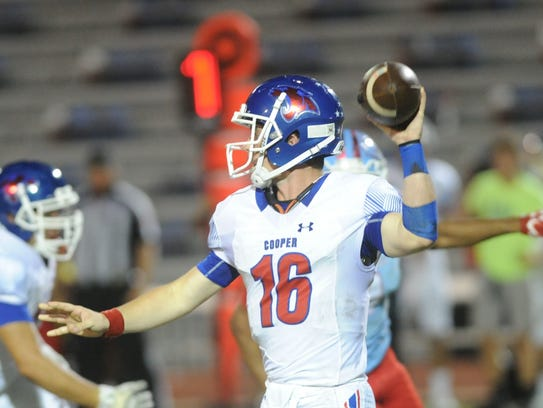 Cooper quarterback Ender Freeman (16) gets ready to