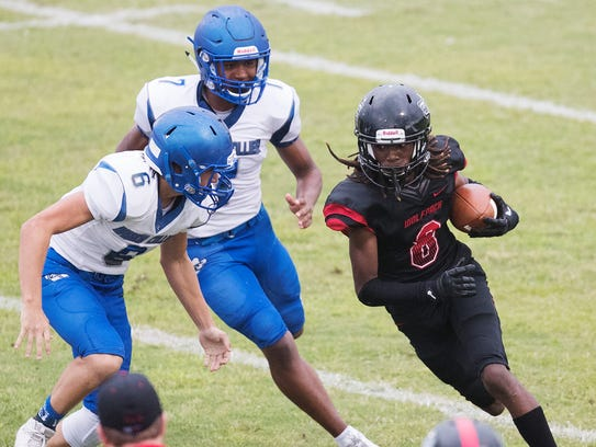 South Fort Myers High School's Malik Curtis eludes