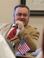 Newly-elected alderman Job Hou-Seye smiles before the