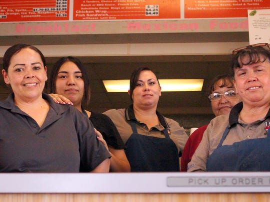 Deming Burger Time employees took time out from prepping the restaurant for sale to take one last group photo. They are, from left,  Anna Mendoza, Yesenia Mendoza, Danielle Leyba, Marieanne Baca and  Becky Leyba.