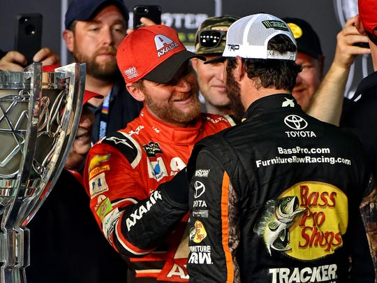 Dale Earnhardt Jr. (88) congratulates  Martin Truex Jr. (78) on winning the NASCAR Cup Championship after the Ford EcoBoost 400 at Homestead-Miami Speedway.