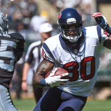 September 14, 2014; Oakland, CA, USA; Houston Texans wide receiver Andre Johnson (80) runs with the ball against Oakland Raiders defensive back Chimdi Chekwa (35) during the first quarter at O.co Coliseum. The Texans defeated the Raiders 30-14. Mandatory Credit: Kyle Terada-USA TODAY Sports