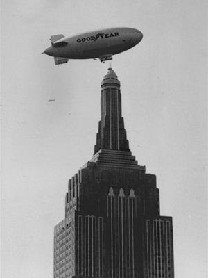 The dirigible Columbia failed in an attempt to pick up mail from the mooring mast of the Empire State Building because of wind resistance in this Sept. 30, 1931, file photo