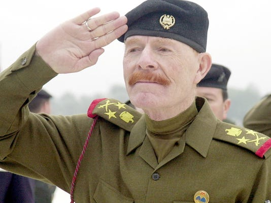 FILE - in this Sunday, Dec. 1, 2002 file photo, Iraqi Vice chairman of the Revolutionary Command Council, Izzat Ibrahim al-Douri salutes during a ceremony at the Martyrs Monument in Baghdad, Iraq. Salahuddin province Gov. Raed al-Jabouri says soldiers and allied Shiite militiamen killed al-Douri early Friday, April 17, 2015 in an operation east of the city of Tikrit. A graphic photo issued by the government purports to be of al-Douri's corpse, but DNA tests are still pending.