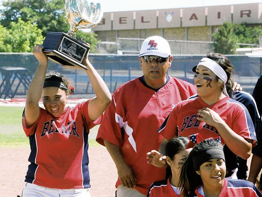 Rudy Gutierrez—El Paso Times Bel Air pitcher Shannon Powell, left, celebrates as she receives the Bi-District championship trophy for her team following their 10-0 shutout of Canutillo Saturlday in their home field.