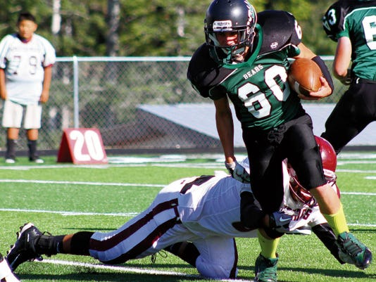 Jarod Gay breaks a tackle from a Ramah defender Saturday afternoon at the Cloudcroft Athletic Field. Cloudcroft defeated Ramah 58-16.