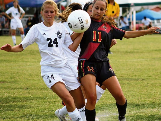 Haley Carr, left, battles Centennial's Hannah Suarez for possession Tuesday evening at the Riner Steinoff Soccerplex.