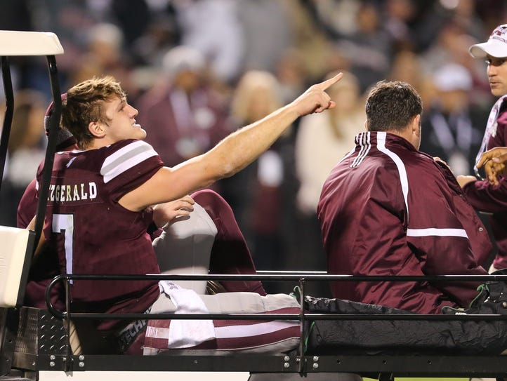 Mississippi State's Nick Fitzgerald (7) points to his