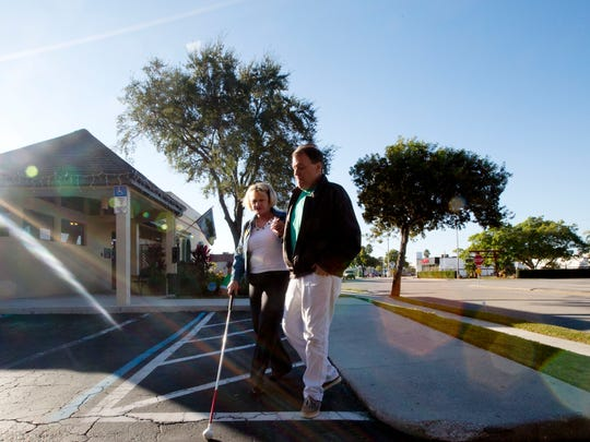 Michael Pierce and his girlfriend, Mary Blum, head to a Cape Coral restaurant after dropping off their guide dogs off at the veterinarian for what they call a spa day. They were dropped off by LeeTran's Passport service. The blind couple's relationship has flourished because of the Passport service.