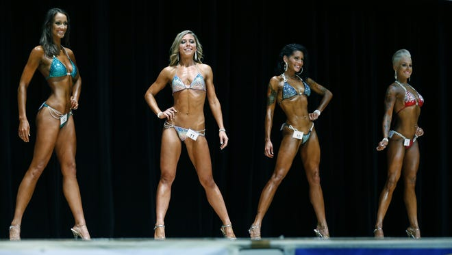Ashley Petty, second from left, participates in the bikini category during her first bodybuilding competition. She won two categories.
