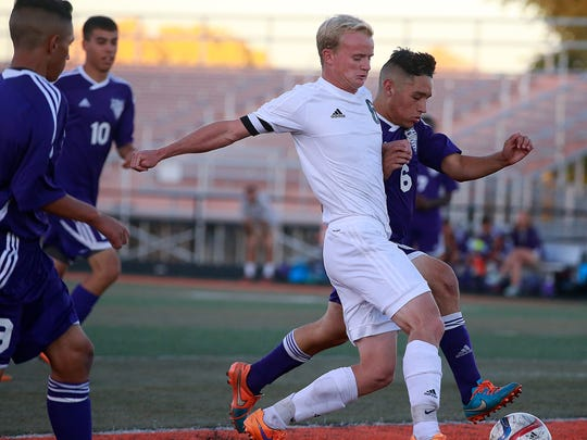 Aztec's Riley Barber, center, scores a goal against Miyamura on Oct. 20 at Fred Cook Memorial Stadium in Aztec.