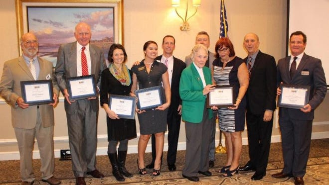 Award recepients honored at the Indian River County Chamber of Commerce annual meeting in 2016.