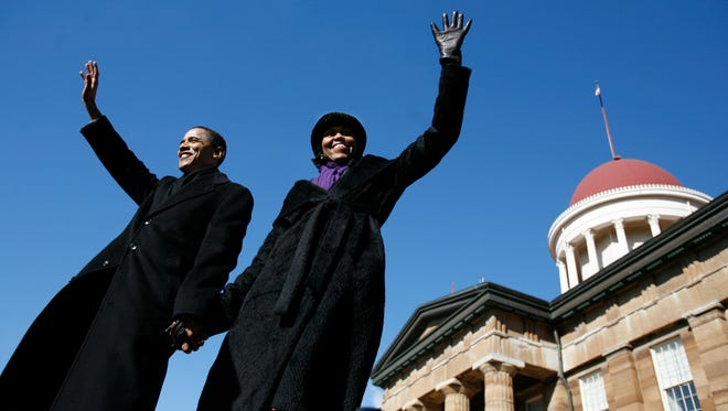 Barack and Michelle Obama wave to supporters after his speech to declare his candidacy for president on Feb. 10, 2007, at the Old State Capitol in Springfield, Illinois.