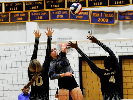 Wylie outside hitter Bailey Ann Toliver kills the ball over an Abilene High block during Tuesday's match at Bulldog Gym.