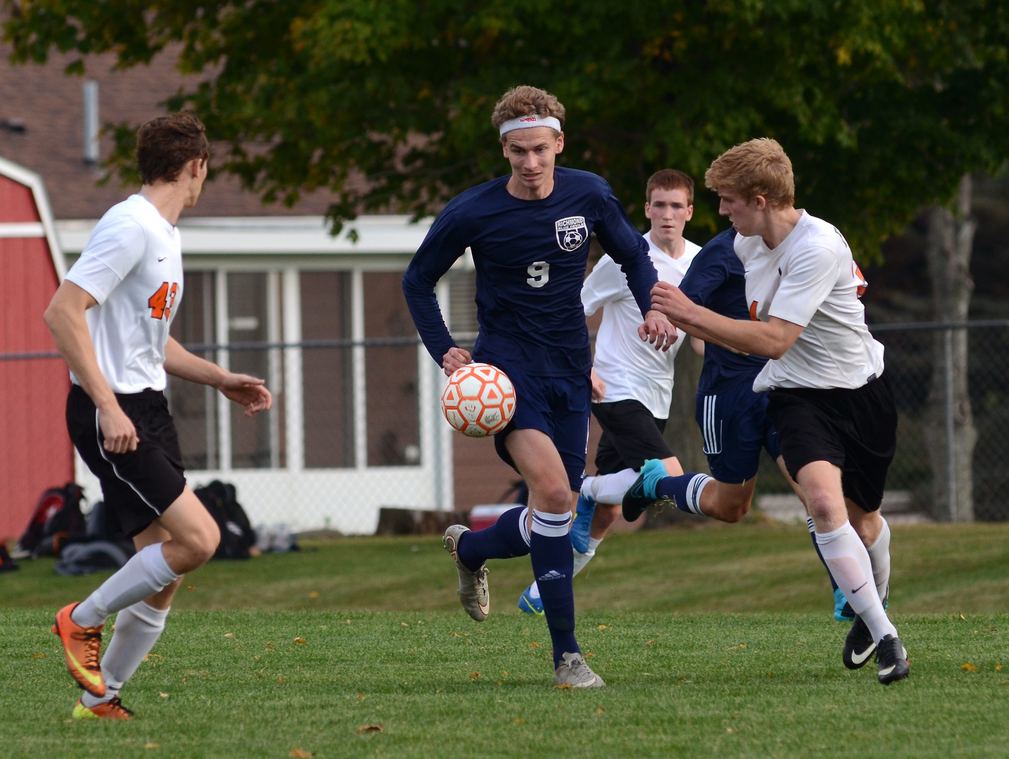 Richmond exchange student Alex Meiniche keeps his eyes on the ball Monday, Oct. 12 during high school soccer action at Almont.