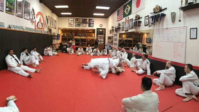 Members of the Gracie Downtown gym practice Brazilian jiu-jitsu.