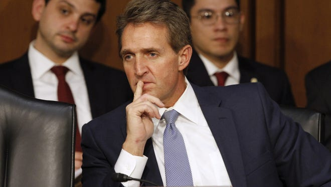 """Sen. Jeff Flake told Capitol Hill reporters that he supports Sen. Ted Cruz's conservative """"Consumer Freedom Option"""" for the Senate health-care bill."""