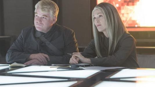 """This image released by Lionsgate shows Philip Seymour Hoffman, left, and Julianne Moore in a scene from """"The Hunger Games: Mockingjay - Part 1,"""" set for release on Nov. 21."""