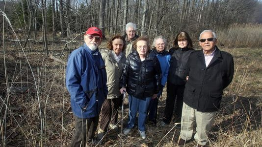 From left, Pomona residents Constantine Gledsos, Joni Anger, Richard Sumner, Marilyn Klass, Doris Sherwood, and Pearl and George Georgiou support their village's ongoing battle to stop plans to build the Congregation Rabbinical College of Tartikov, which doesn't fit into zoning regulations, but endeavors to build, citing the federal Religious Land Use and Institutionalized Persons Act, known as RLUIPA.