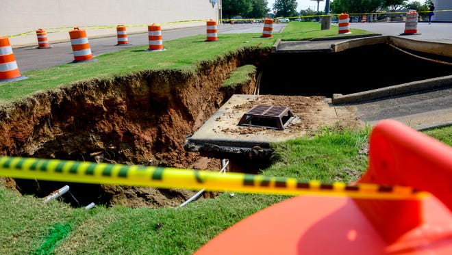 A cave-in occurred near a storm drain and a rear parking lot at Walker Road behind Target on Sunday in Jackson, Tenn., as shown on Monday, Aug. 13, 2018.