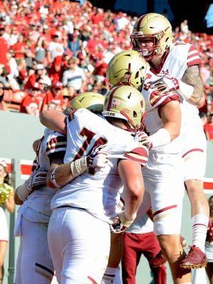 Boston College tight end Tommy Sweeney is congratulated by teammates after scoring a touchdown during the second half against the North Carolina State Wolfpack at Carter Finley Stadium. Boston College won 21-14.