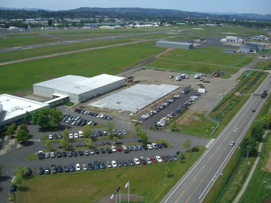 An aerial image shows the beginning of the latest Garmin expansion, a $14 million project, with the Salem Airport in the background.