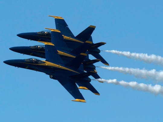 The Blue Angels soar overhead during the annual Breakfast