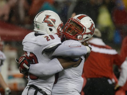 Jordan Thompson and Jeremy Larkin celebrate La Salle's state championship.